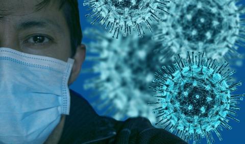 Мужчина в маске и вирусы в воздухе